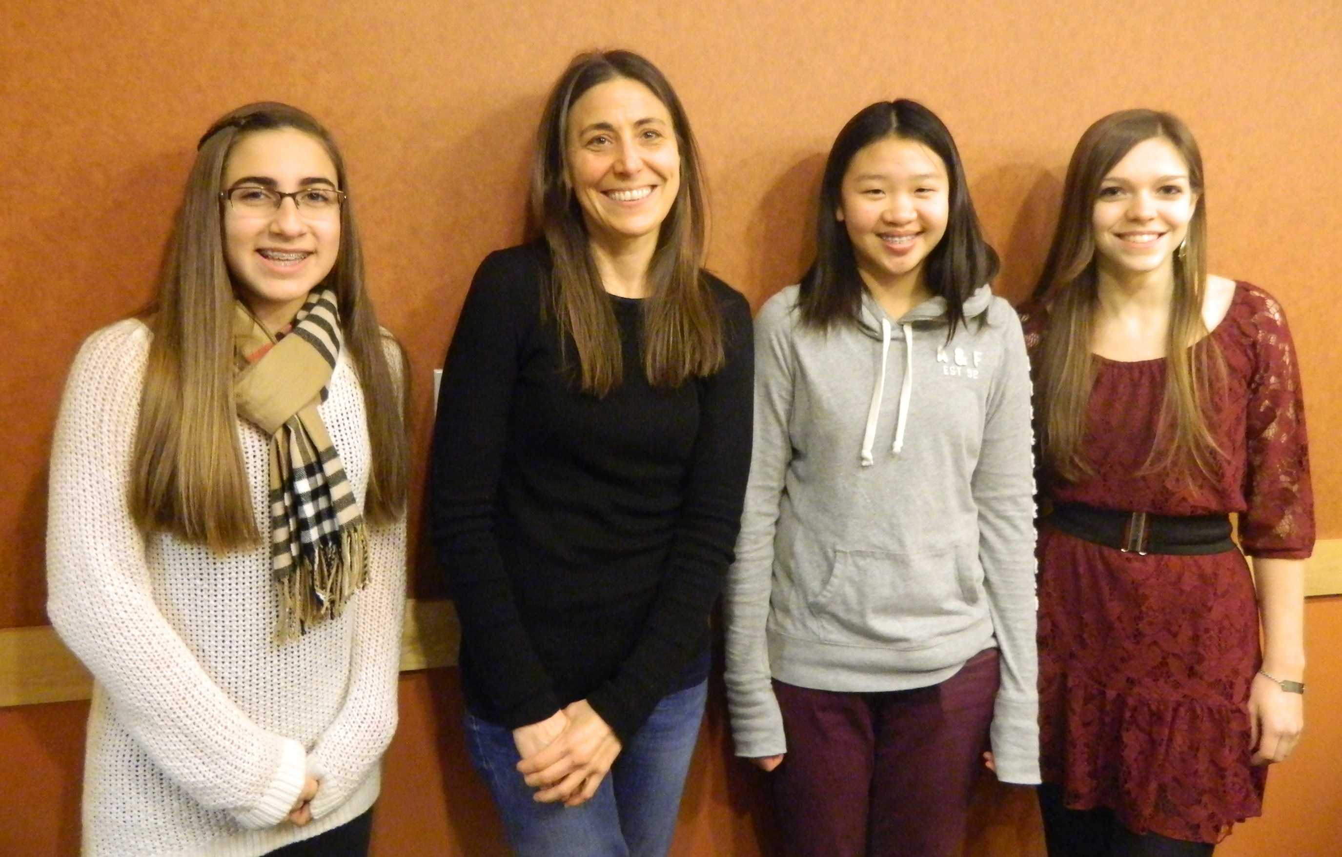 Rebecca Stead (second from left) poses with reporters from the Watertown public school newspapers during the author's visit to Lesley University in Cambridge, Mass., on Jan. 8, 2014.