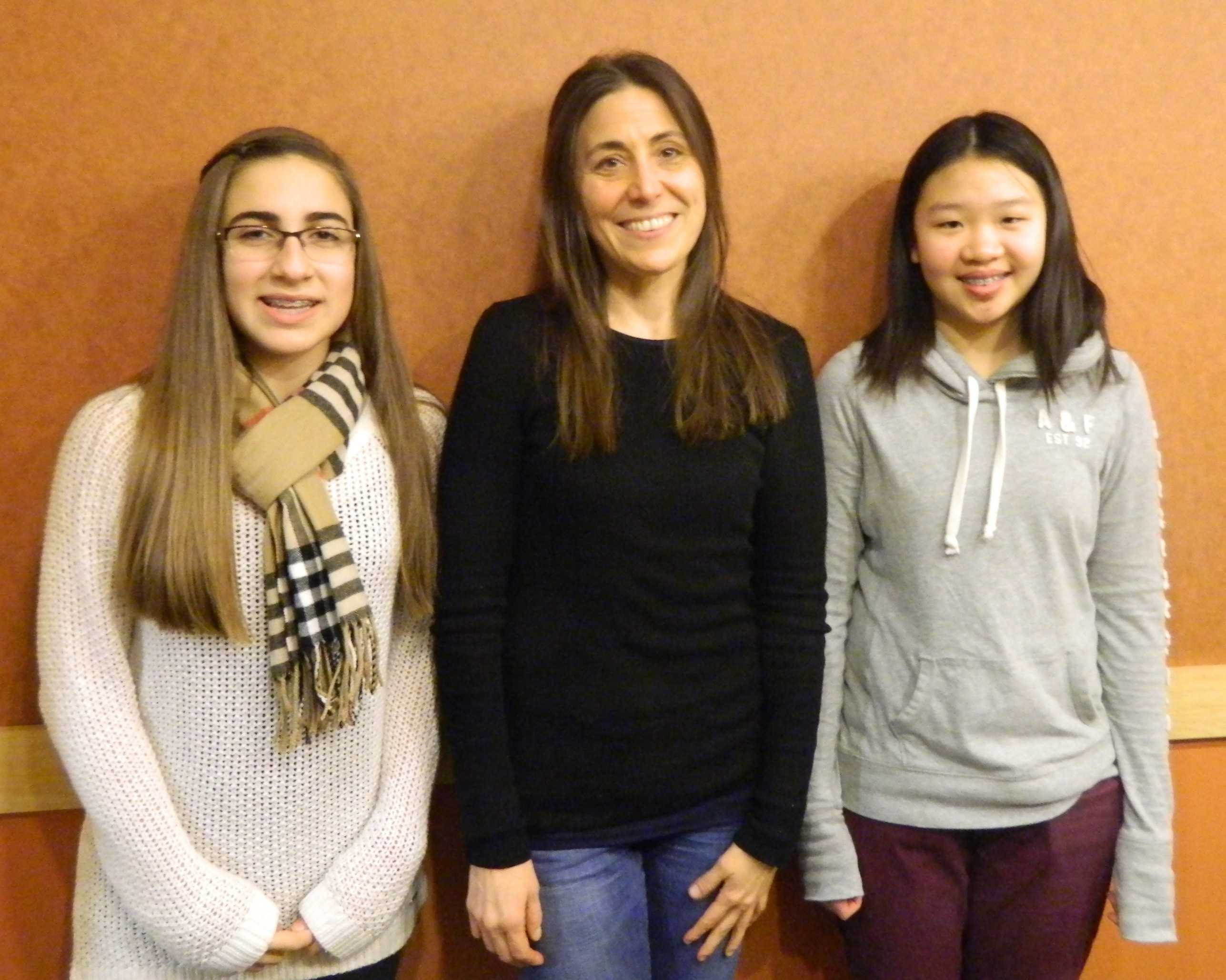 Author Rebecca Stead (center) poses with reporters from the Watertown Splash during a visit to Lesley University in January.