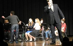 """Principal Kimo Carter (right) sings """"Mack the Knife"""" with the WMS Jazz Band, conducted by Anthony Spano (left), the opening act during the annual Watertown Middle School Talent Show on Wednesday night, April 16, 2014."""