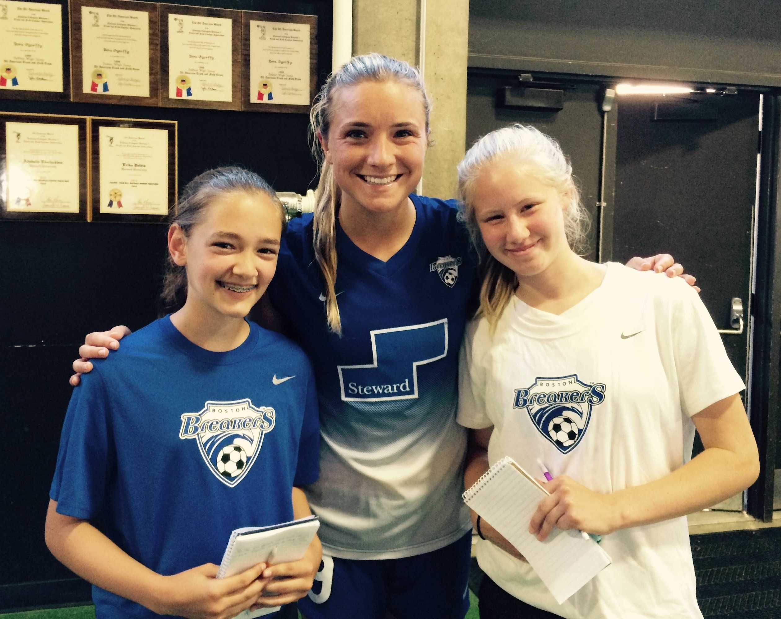 Kristie Mewis of the Boston Breakers (center) poses with reporters from the Watertown Splash newspaper following the Breakers' 3-2 loss to the Seattle Reign on June 21, 2015.