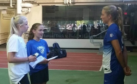 Kristie Mewis of the Boston Breakers (right) talks with reporters following the Breakers' 3-2 loss to the Seattle Reign on June 21, 2015.