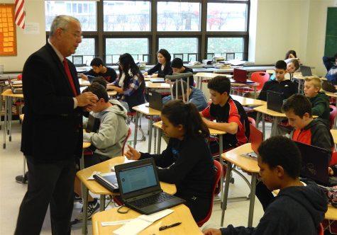 Dr. John Brackett (left), the Watertown Public Schools interim superintendent, speaks with Watertown Splash reporters in the newsroom at Watertown Middle School on Nov. 16, 2016.