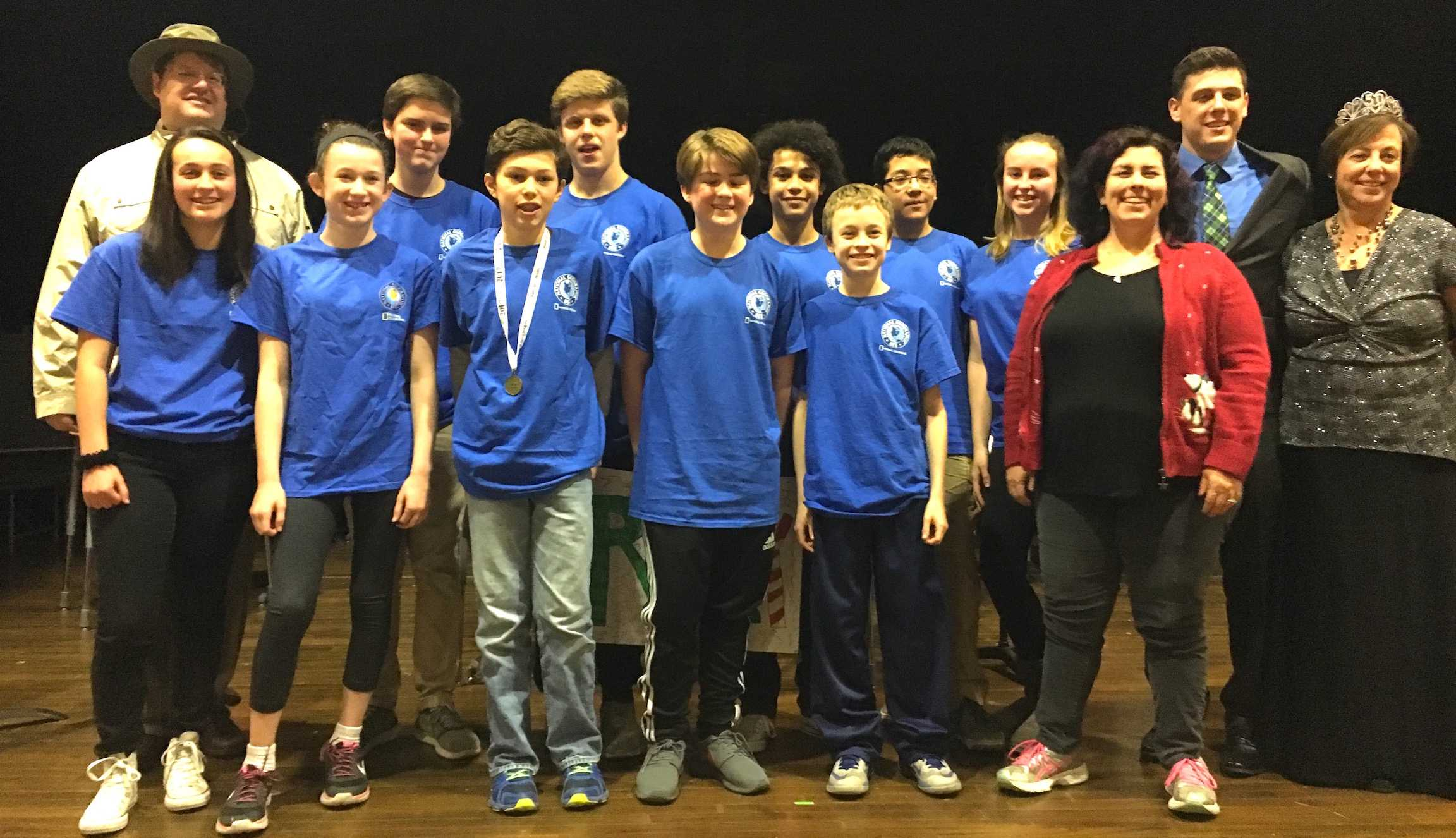 The finalists and organizers pose with Henry Yusem (wearing ribbon and medal) after he won the annual Geography Bee at Watertown Middle School on Dec. 23, 2016.