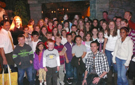 More than 50 representatives of scholastic journalism in the Watertown schools surround actor Matthew Lewis (front row in black-and-white shirt), who plays Neville Longbottom in the Harry Potter films, at a Museum of Science press preview Oct. 22, 2009.
