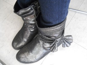 Shiny boots are a hit in fall.
