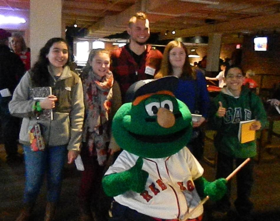 Watertown+Splash+reporters+and+Red+Sox+pitcher+Drake+Britton+are+photo-bombed+by+Wally+the+Green+Monster+during+the+%E2%80%9CNew+Stars+for+Young+Stars%E2%80%9D+fund-raising+event+for+the+Jimmy+Fund+at+Jillian%27s+on+Jan.+11%2C+2014.+Other+Red+Sox+players+at+the+event+included+Rubby+De+La+Rosa%2C+A.J.+Pierzynski%2C+Mookie+Betts%2C+and+Blake+Swihart.+