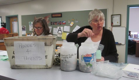 Laurie Brackett (left) and Eleanor Donato count the first round of donations at Watertown Middle School during the annual Pennies for Patients drive to help the Leukemia & Lymphoma Society in its fight against cancer. This year's drive runs from March 2 to March 23.