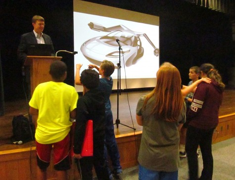Carl Dietrich of Terrafugia talks flying cars with interested Watertown Middle School students after his presentation on Oct. 7, 2015.