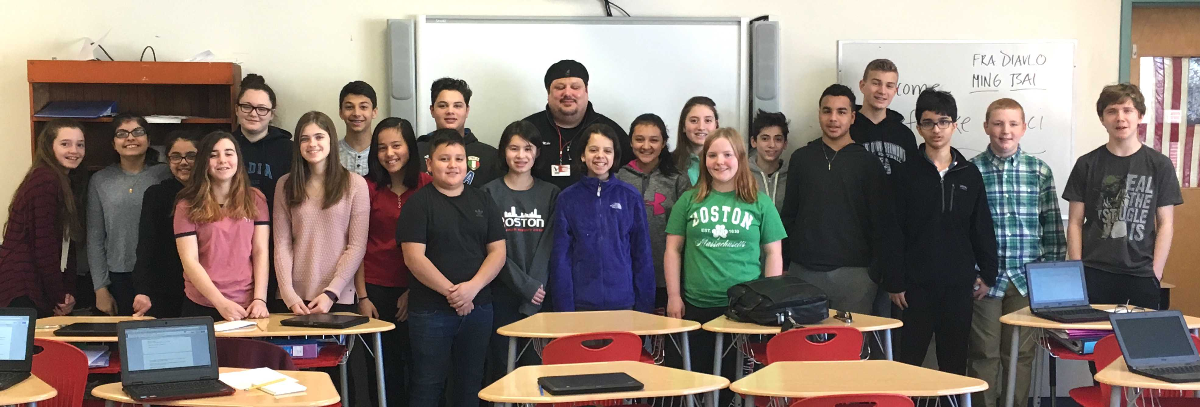 Watertown chef Mike Fucci (center, with hat) poses with reporters from the Watertown Splash during his visit to Watertown Middle School on March 17, 2017. The author and owner of Chef Mike's Catering was interviewed in the Watertown Splash newsroom about his victorious appearance on Food Network's