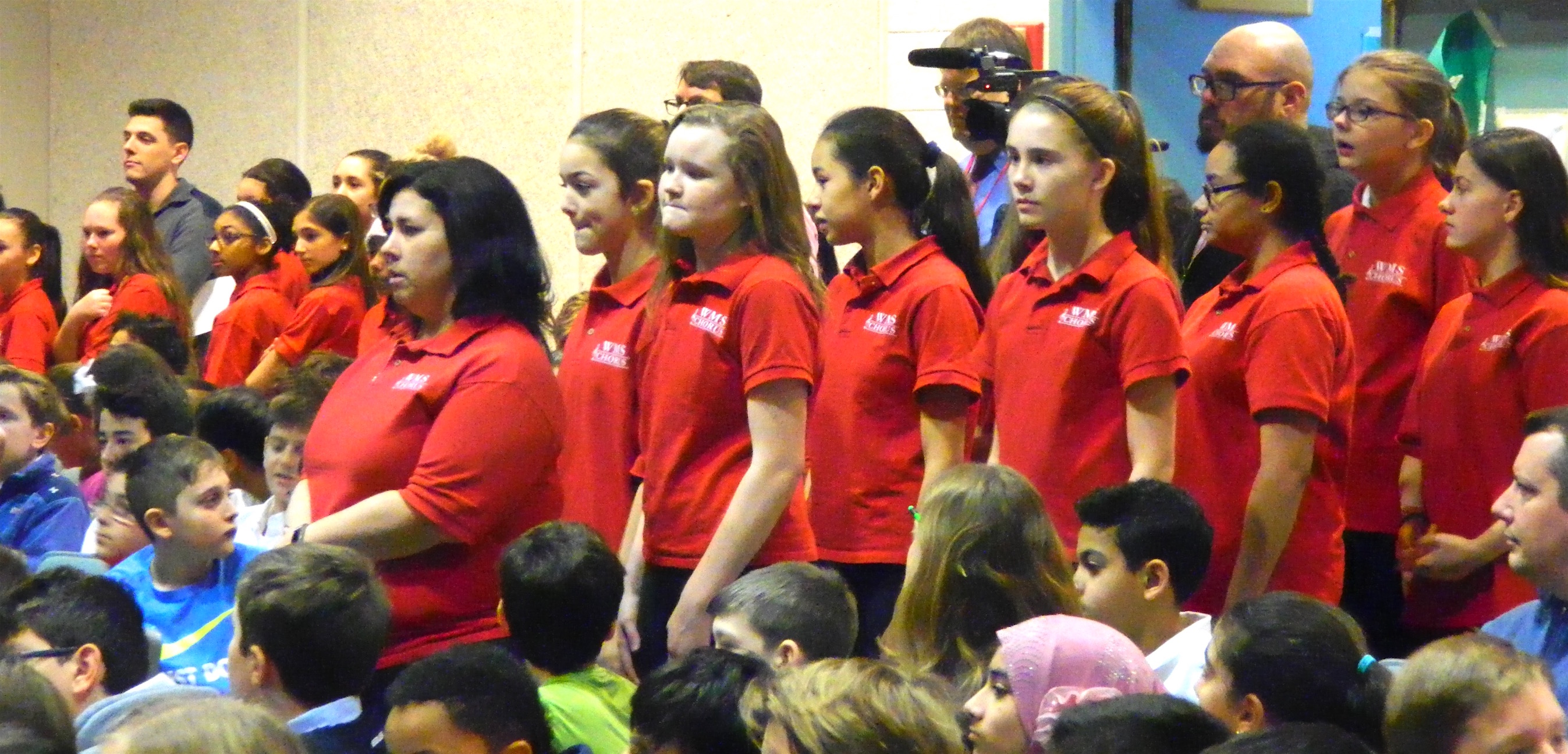 Abby Casey (front left) led the Watertown Middle School chorus in the two Winter Concert performances, Dec. 13 and 16, 2016.