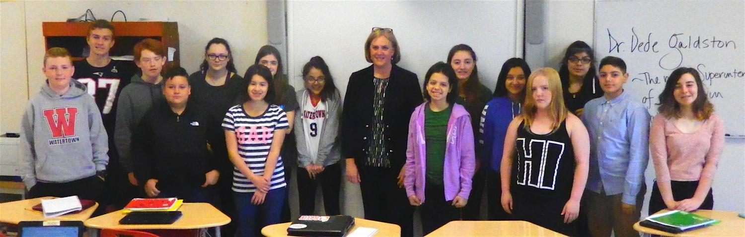 Dr. Deanne Galdston (center), the incoming superintendent of Watertown Public Schools, poses with Watertown Splash reporters during an interview in the newsroom on May 4, 2017.