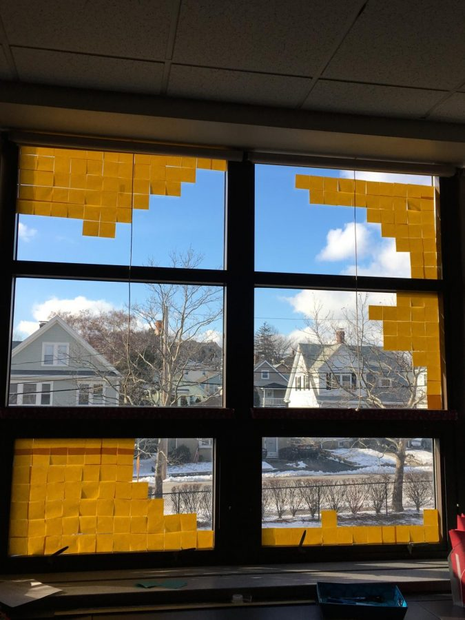 A window design made with Post-its at Watertown Middle School. Margaret Ferguson's homeroom chose to make flags of the students' home countries.