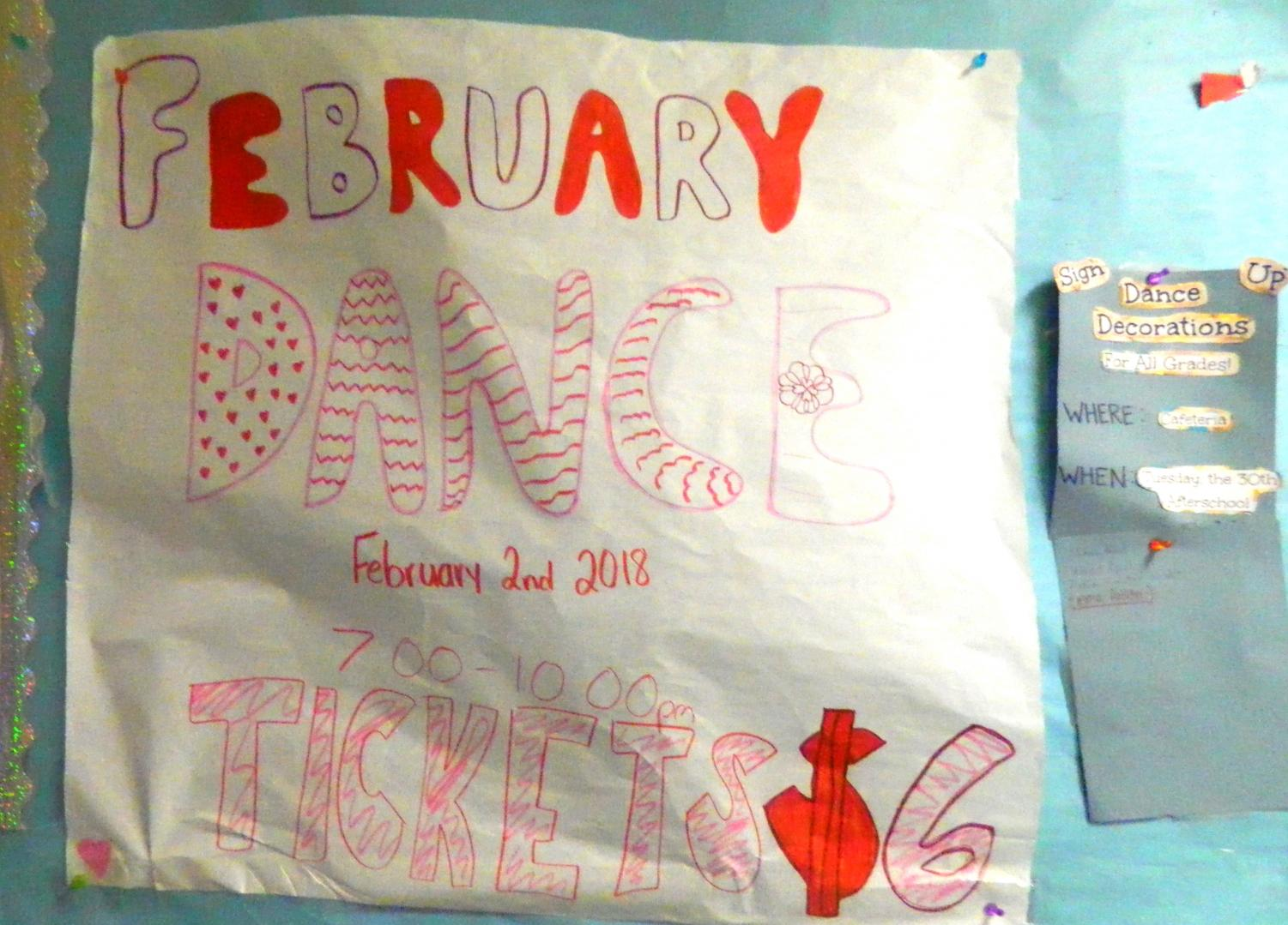 Sign advertising the upcoming Valentines dance at Watertown Middle School.