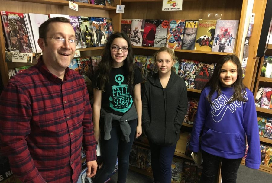 Store owner David Philbrick (left) poses with reporters from the Watertown Splash after a recent interview at The Comic Stop at 134 Main St. in Watertown, Mass.