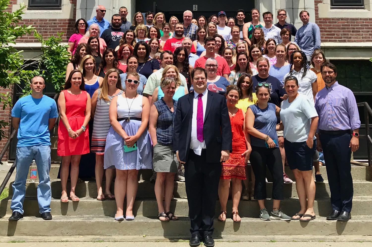 The staff of Watertown Middle School poses for a photo with Kimo Carter (front row, center) on June 22, 2018, his last day as principal after 13 years.