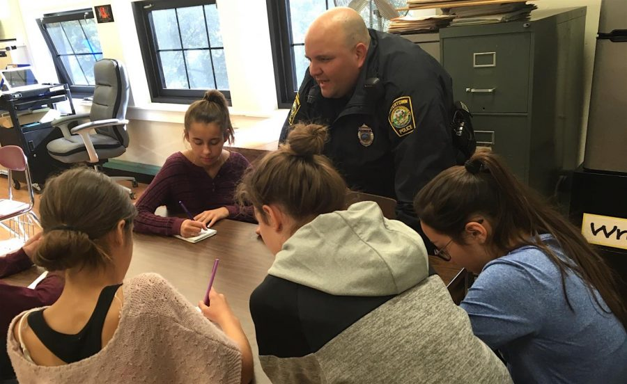Officer Miguel Colon of the Watertown Police Department talks about the recent ALICE training at Watertown Middle School with reporters from the Watertown Splash.