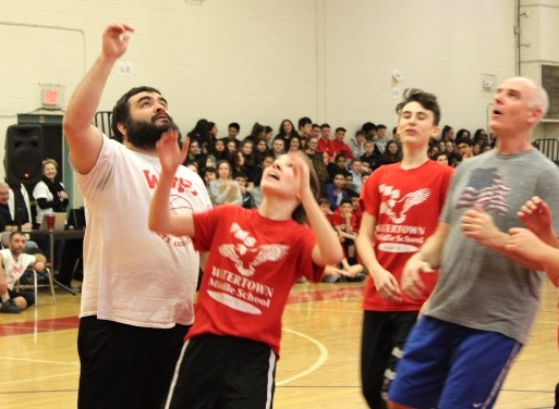 Brian Donato (left) participated in the recent basketball game between the Watertown Middle School faculty and the eighth-graders.