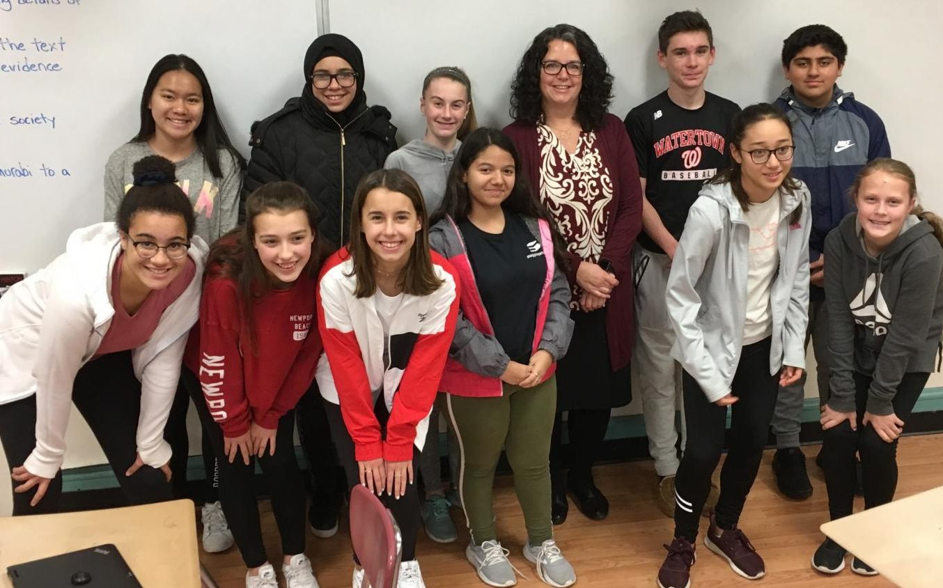 New Watertown Middle School principal Donna Martin (back row, third from right), poses with student reporters after a recent interview in the Watertown Splash newsroom.