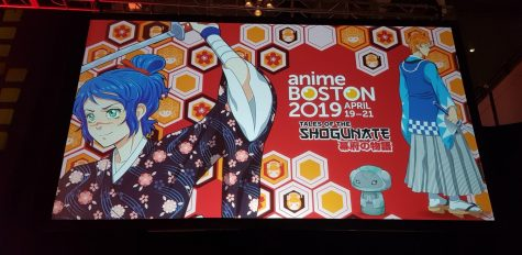The official poster and theme of Anime Boston 2019 hangs inside the Hynes Convention Center during the first day, Friday, April 19.