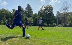 Zerihun Flessas takes a kick-in -- instead of a throw-in -- one of the new rules in play for youth soccer teams this fall.